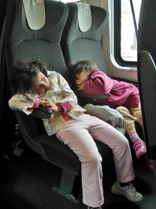 Portrait of Syrian girls sleeping on the refugee train