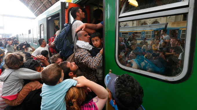 Migrants fight to get on board a train at Budapests Keleti station Credit Reuters